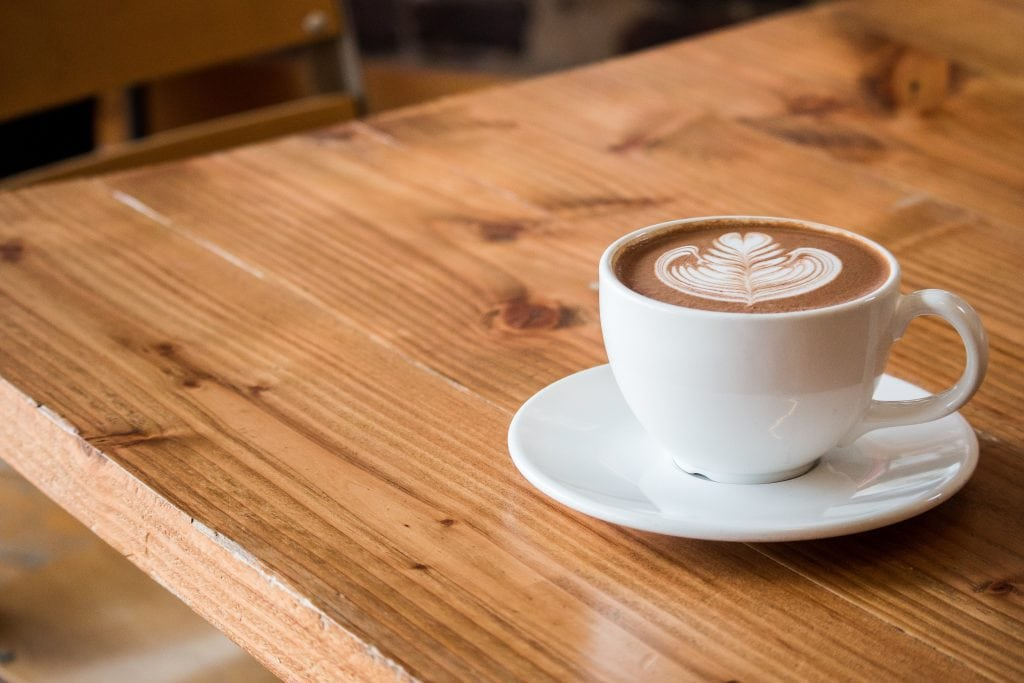 Italian cappuccino cup on a wooden table