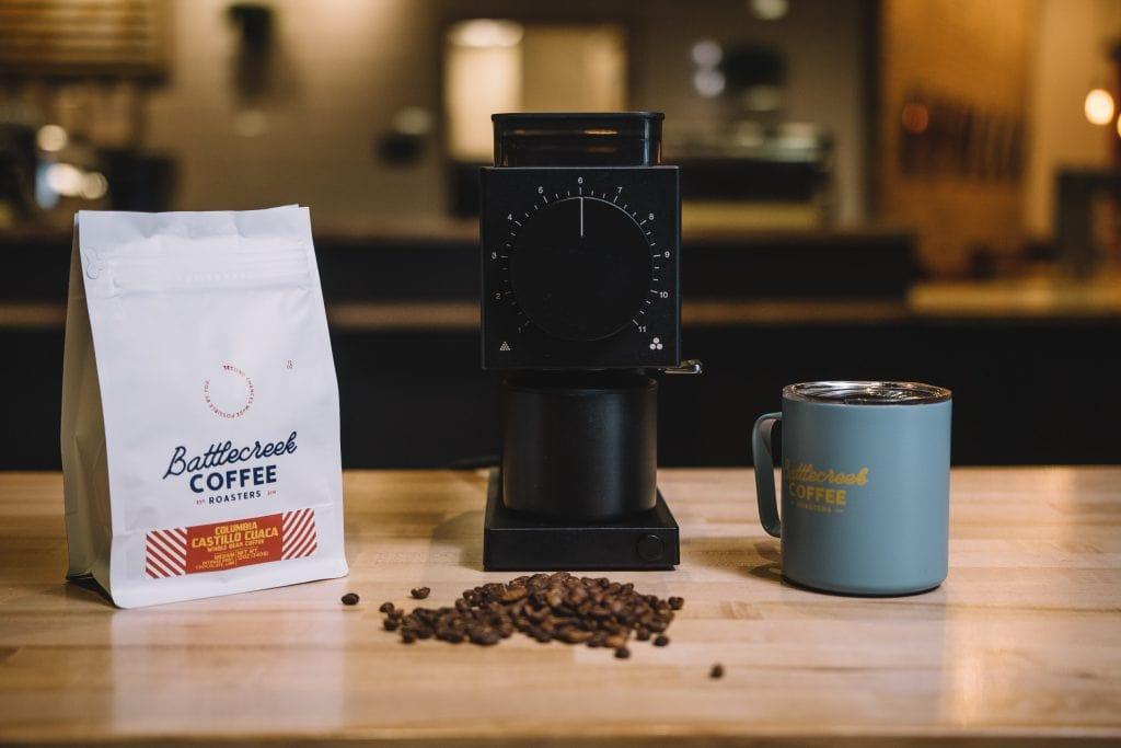 Fellow Ode coffee grinder along with a Battlecreek coffee bag.