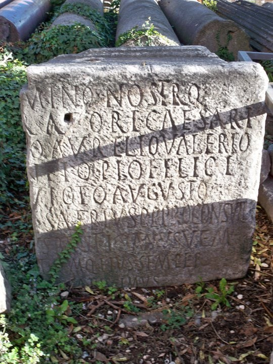 A stone with the name of the ruling emperor written. Aurelio Valerio is easy to read.