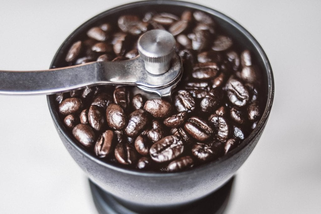 Coffee grinder filled with beans