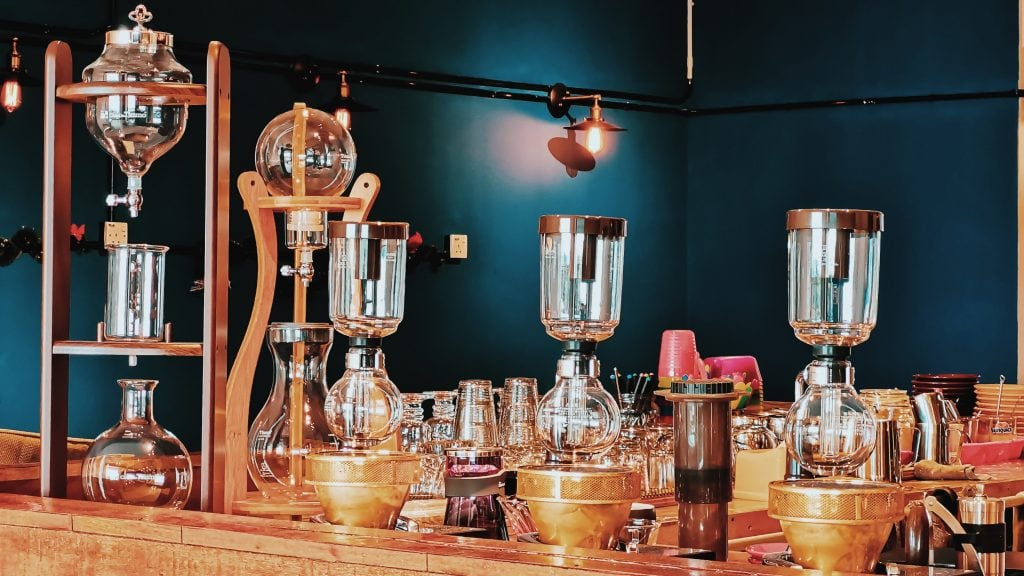 Coffee brewing devices in a coffee shop bar.