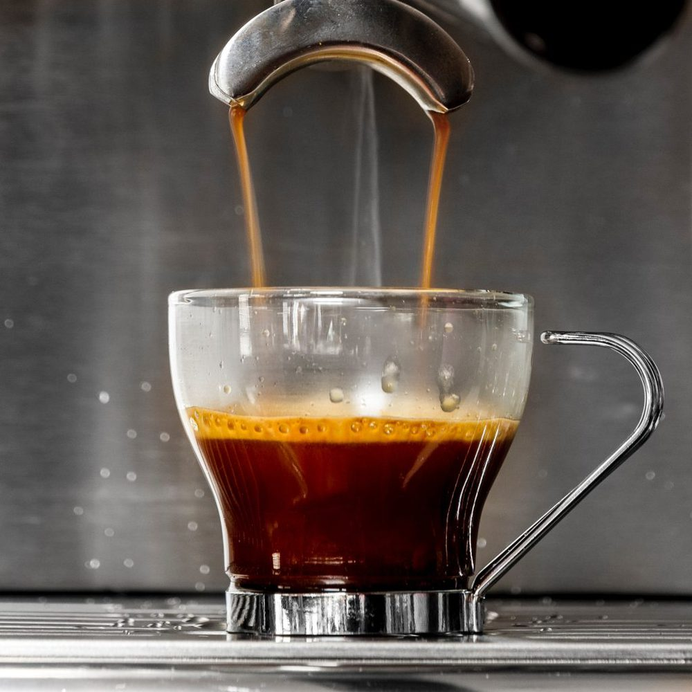 Close up of an espresso machine dialing a shot