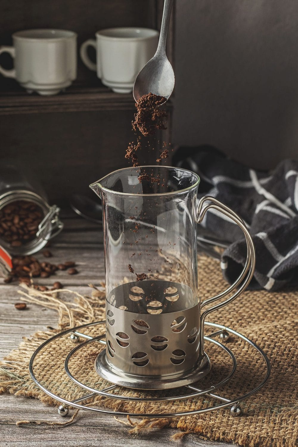 Adding ground coffee into the French press