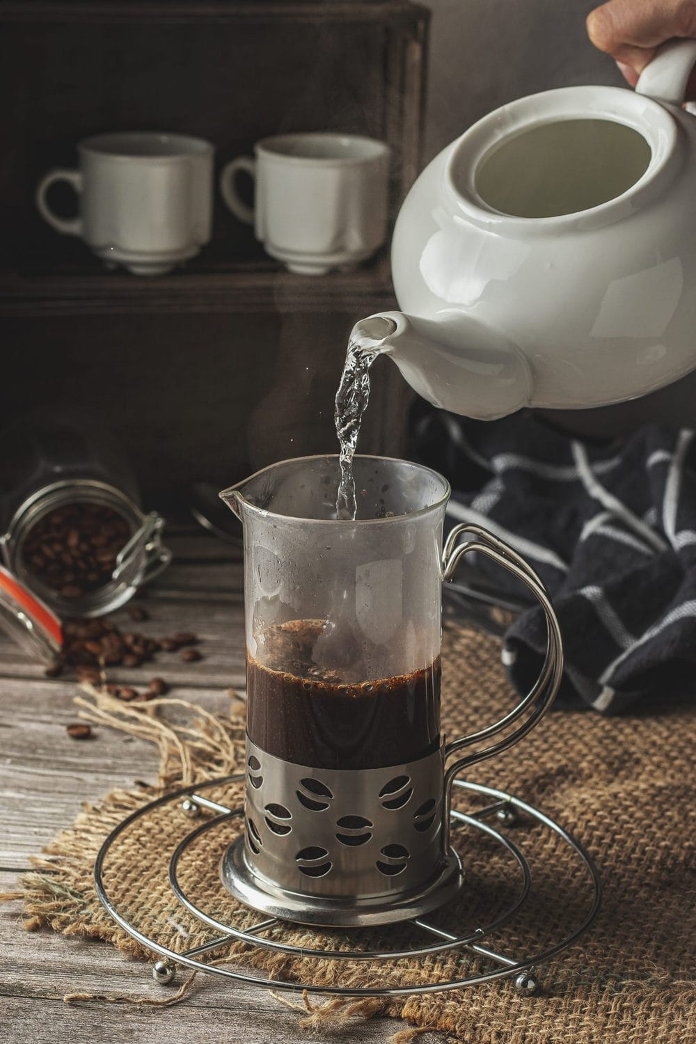 Pouring water over the coffee bed