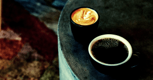 An espresso based drink along with a cup of drip coffee