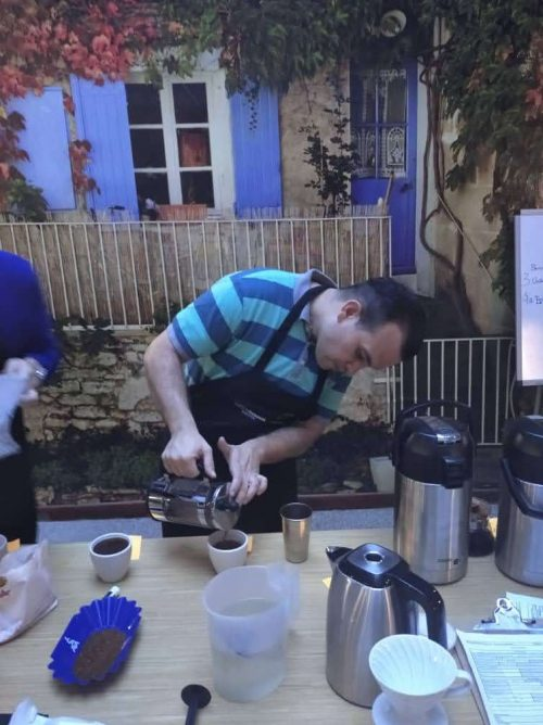 Yker Valerio brewing coffee with a french press